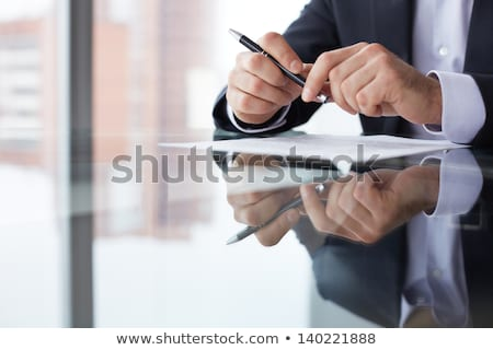 Foto stock: Caucasian Businessman Signing Business Papers