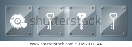 Musical treble clef key to open love heart lock shape Stock photo © orensila