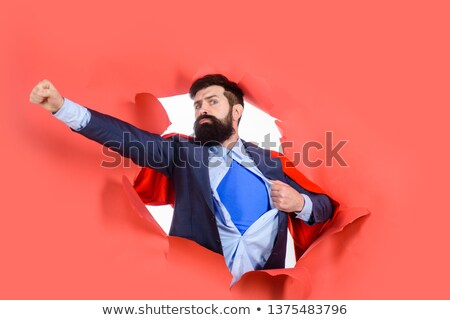 Brave superhero man in costume with red Stock photo © LoopAll
