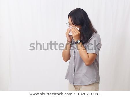 Young asian sick woman sneezing. Stock photo © RAStudio