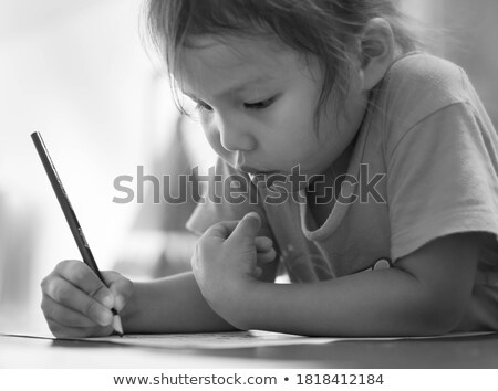 Girl holding piece of paper with handwriting Stock photo © IS2