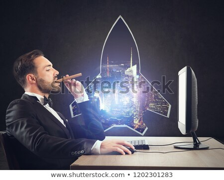 successful business man wants to improve himself concept of startup with a rocket shape hole in the stock photo © alphaspirit