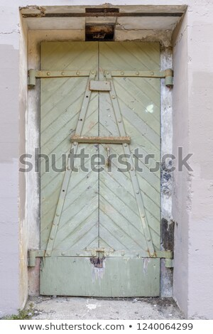 ruins of a metal door at battery west presidio of san francisco california usa stock photo © yhelfman