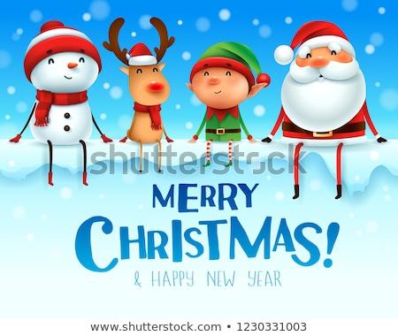 Merry Christmas! Happy Christmas companions sit on big signboard Stock photo © ori-artiste