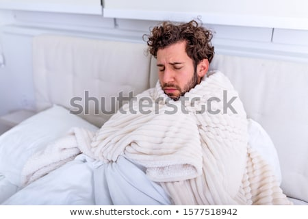 Portrait of Young Caucasian man in bed with headache Stock photo © Lopolo