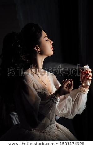 Tender beautiful bride's hands on white dress Stock photo © ruslanshramko