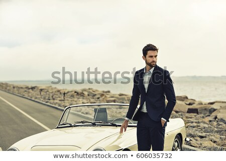 Stock photo: Handsome business man on a convertible car
