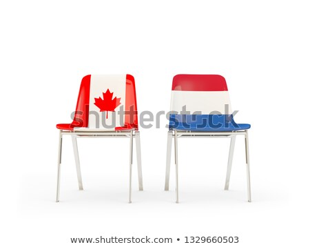Two chairs with flags of Canada and netherlands Stock photo © MikhailMishchenko