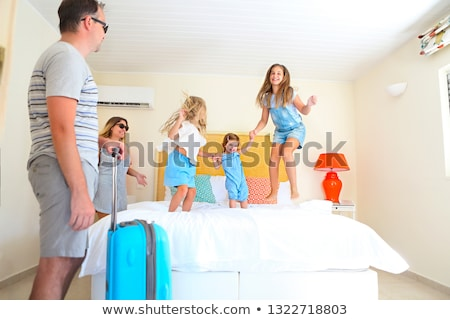 Family with three kids with luggage in hotel room  Stock photo © dashapetrenko