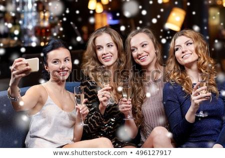 женщины шампанского ночной клуб счастливым смартфон Сток-фото © AndreyPopov