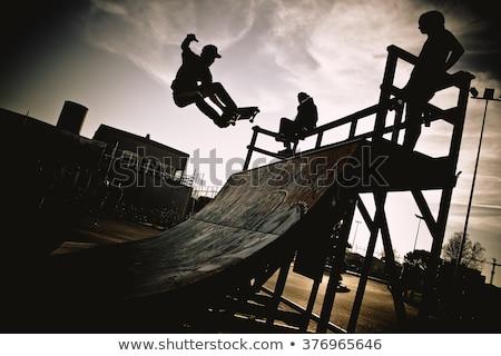guy riding skateboard in city stock photo © jossdiim