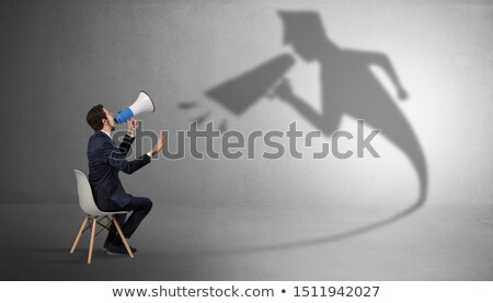 Businessman staying and offering stuffs to his bossy shadow Stock photo © ra2studio
