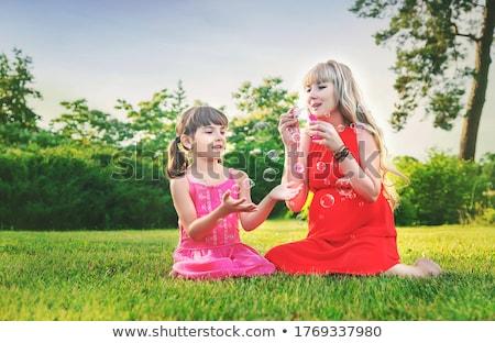 Zwangere moeder dochter zeepbellen zwangerschap mensen Stockfoto © dolgachov