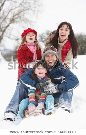 Fiatal család szórakozás tájkép nő hó Stock fotó © monkey_business