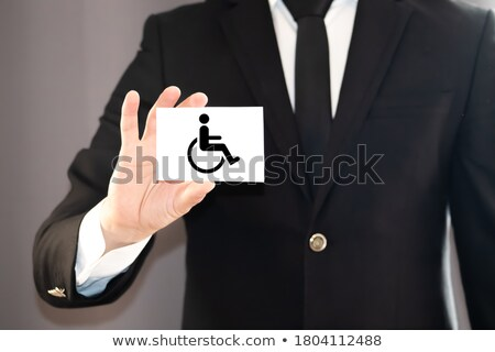 hands holding paper with cutout disabled sign stock photo © andreypopov