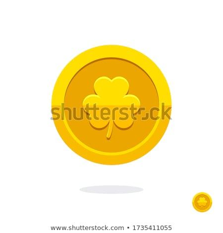 Mani monete shamrock foglia fortuna Foto d'archivio © dolgachov