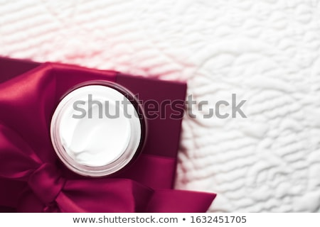 Luxury face cream for sensitive skin and maroon holiday gift box Stock photo © Anneleven