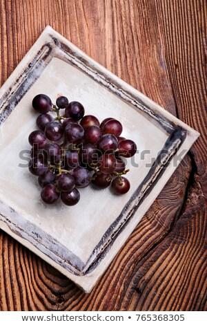 Fekete szőlő kézzel készített tér cserépedények tányér Stock fotó © przemekklos