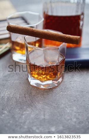 Zdjęcia stock: Carafe Of Whiskey Or Brandy Glasses And Box Of Finnest Cuban Cigars