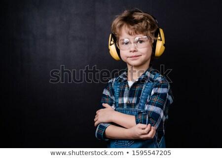Cute weinig jongen werkkleding hoofdtelefoon bril Stockfoto © pressmaster