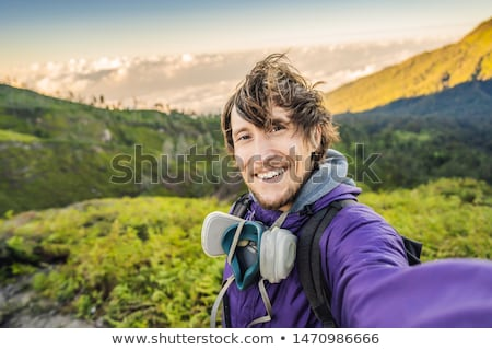The magnificent views on green mountains from a mountain road trecking to the Ijen volcano or Kawah  Stock photo © galitskaya