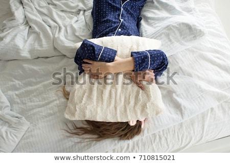 sleepy yawning young woman in pajama with pillow Stock photo © dolgachov