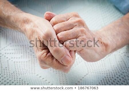 Elderly Male hand with Rheumatoid Arthritis Stock photo © 808isgreat