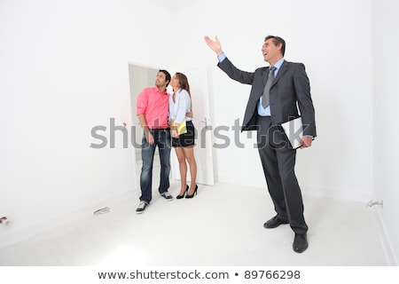 Stock photo: Couple being shown around property by estate-agent