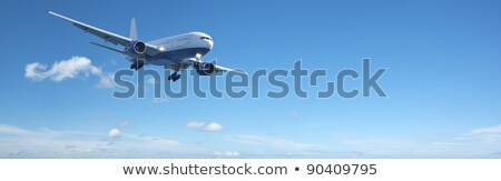 Foto stock: Jet Aircraft In A Blue Sky Panoramic Composition
