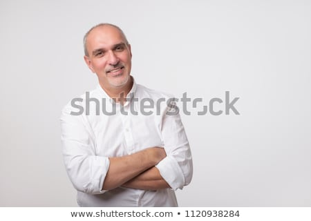 portrait of a business man against grey background studio shot stock photo © hasloo