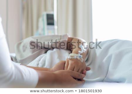 Reconfortante doente pessoas mão tocante Foto stock © lorenzodelacosta