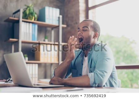 Man yawning in front of his laptop Stock photo © photography33