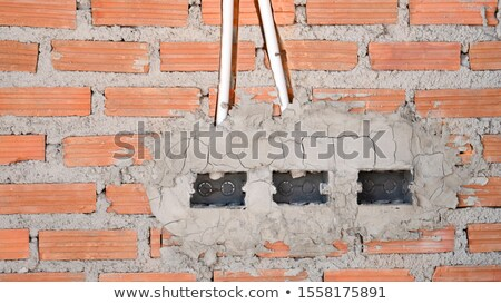 Integration of electricity pipe on house wall stock photo © pinkblue