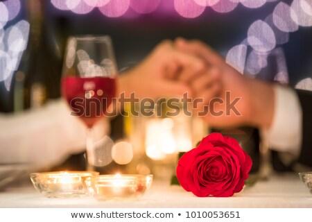 girl red wine and rose petals stock photo © zastavkin