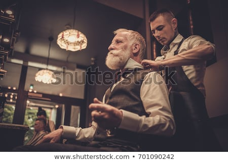 Senior man at work as barber shaving customer  Stock photo © diego_cervo