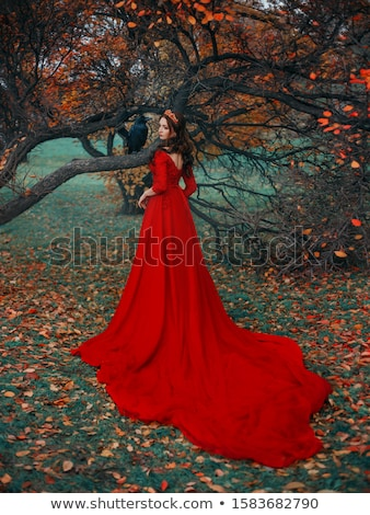 Fairy tale - beauty woman in fashion red dress sitting in forest Stock photo © gromovataya