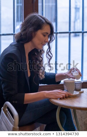 Woman drinking a glass of milk on a mirrored table Stock photo © photography33