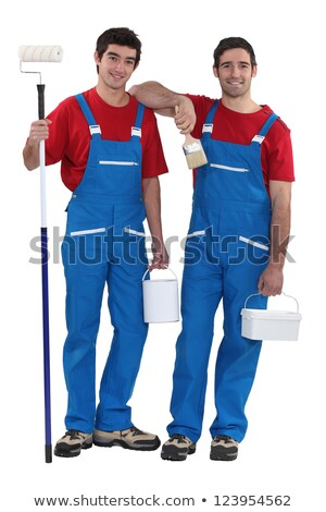 Two decorators dressed in the exact same outfit Stock photo © photography33