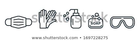 Rubberen handschoenen geïsoleerd witte hand achtergrond schoonmaken Stockfoto © kitch