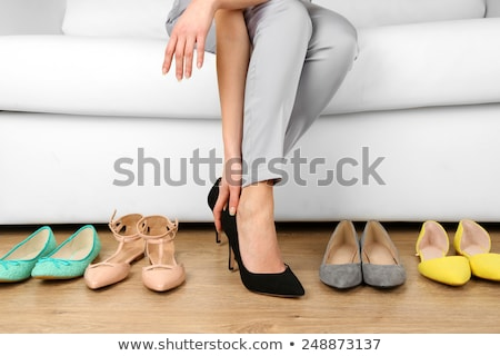 Woman trying on shoes on white background stock photo © alexandkz