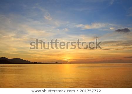 céu · dourado · pôr · do · sol · água · sol · paisagem - foto stock © jaymudaliar