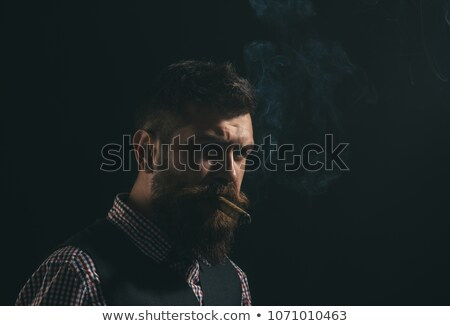 Portrait of the young man with cigar. Isolated Stock photo © acidgrey