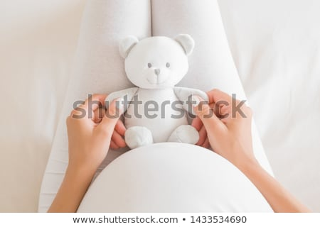 Pregnant woman with a cuddly toy at home Stock photo © wavebreak_media