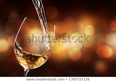 White wine swirling in a glass Stock photo © Hofmeester