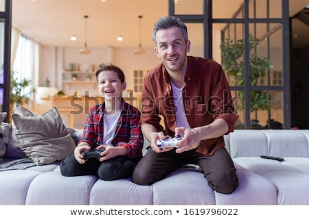 father and son having fun playing video games stock photo © photography33