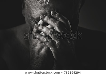 Foto stock: Close Up Of Man Suffering From Headache