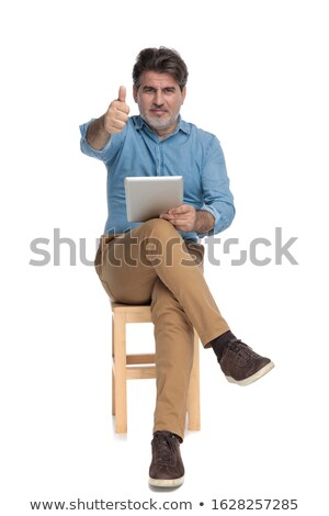 casual old man sits holds laptop and ok sign stock photo © feedough