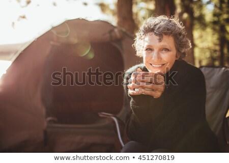 beautiful senior woman enjoying a cup of coffee stock photo © hasloo