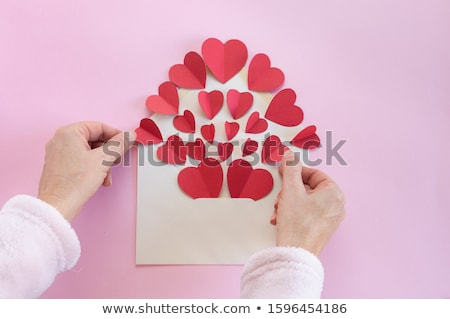 woman writing valentine card Stock photo © chesterf