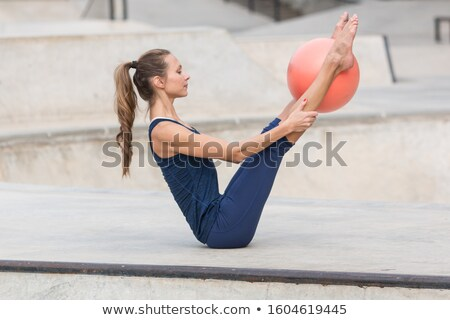 young woman holding small fitness ball stock photo © stepstock
